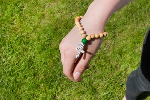 Person wearing a Christian prayer bracelet.